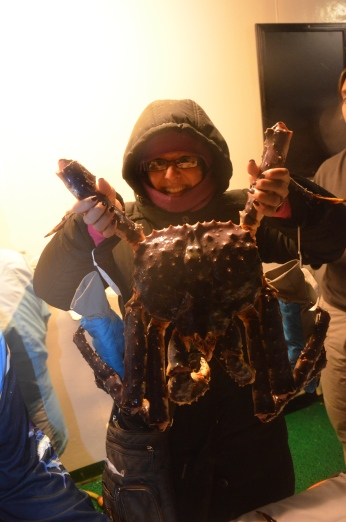 Holding up a giant Alaskan King Crab
