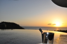 Champagne in the infinity pool at sunset