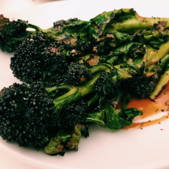 Chargrilled purple sprouting broccoli, miso tahini, poppy seeds